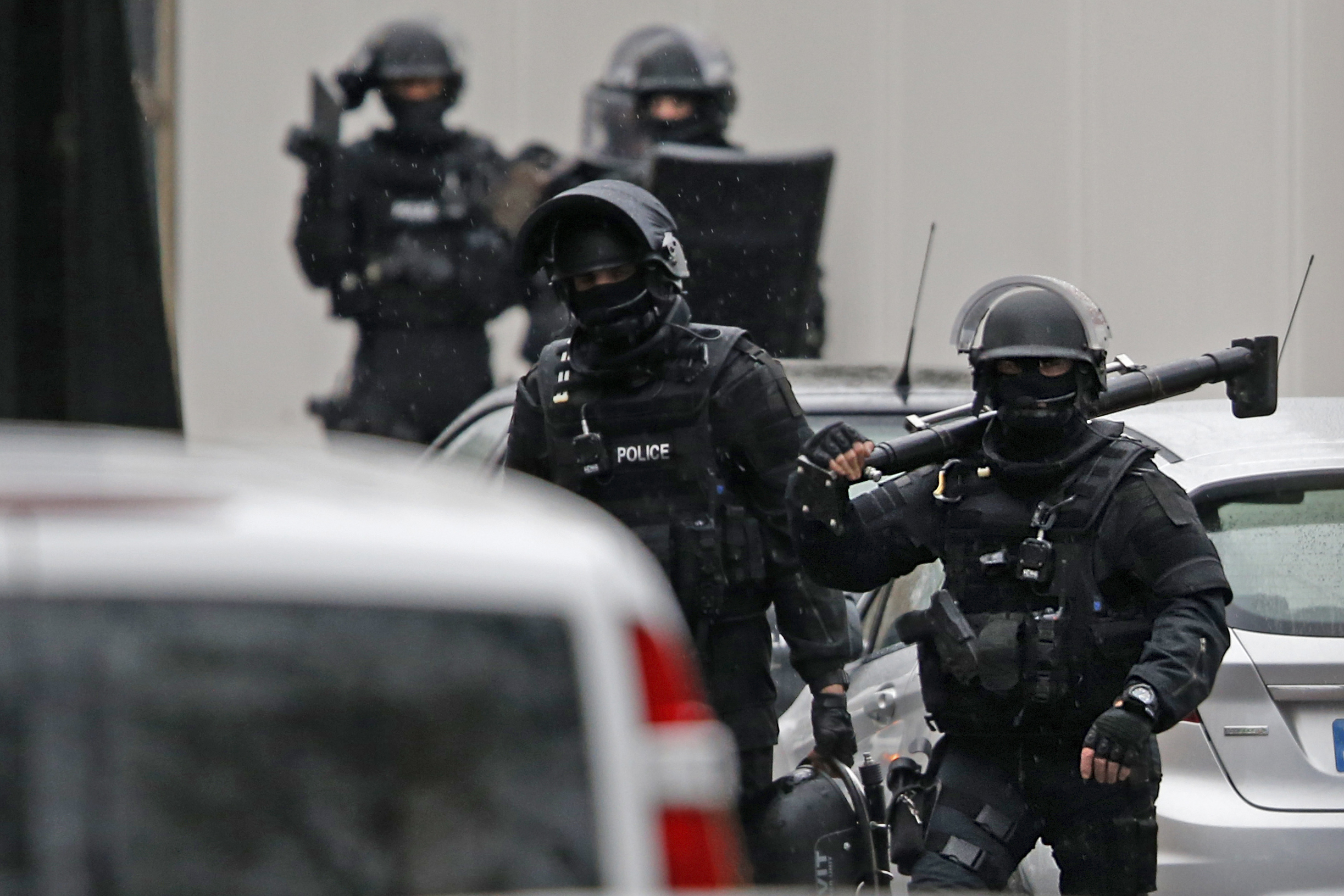 Members of French special police forces of Research and Intervention Brigade (BRI) are seen at the scene of a shooting in the street of Montrouge near Paris January 8, 2015. A policewoman was killed in a shootout in southern Paris on Thursday, triggering searches in the area as the manhunt widened for two brothers suspected of killing 12 people at a satirical magazine in an apparent Islamist militant strike. Police sources could not immediately confirm a link with the killings at Charlie Hebdo weekly newspaper which marked the worst attack on French soil for decades and which national leaders and allied states described as an assault on democracy. REUTERS/Charles Platiau (FRANCE - Tags: MILITARY CRIME LAW) - RTR4KKLE