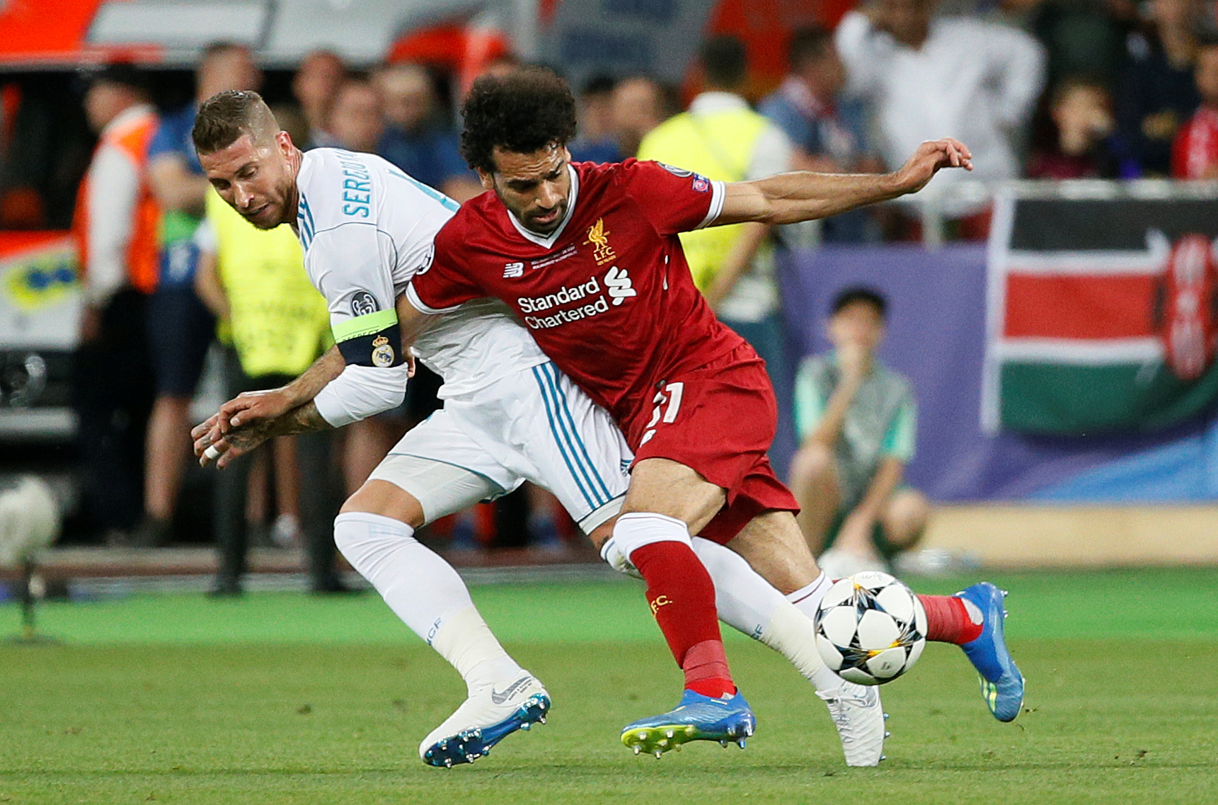 Soccer Football - Champions League Final - Real Madrid v Liverpool - NSC Olympic Stadium, Kiev, Ukraine - May 26, 2018   Liverpool's Mohamed Salah injures his shoulder in a challenge with Real Madrid's Sergio Ramos      REUTERS/Gleb Garanich