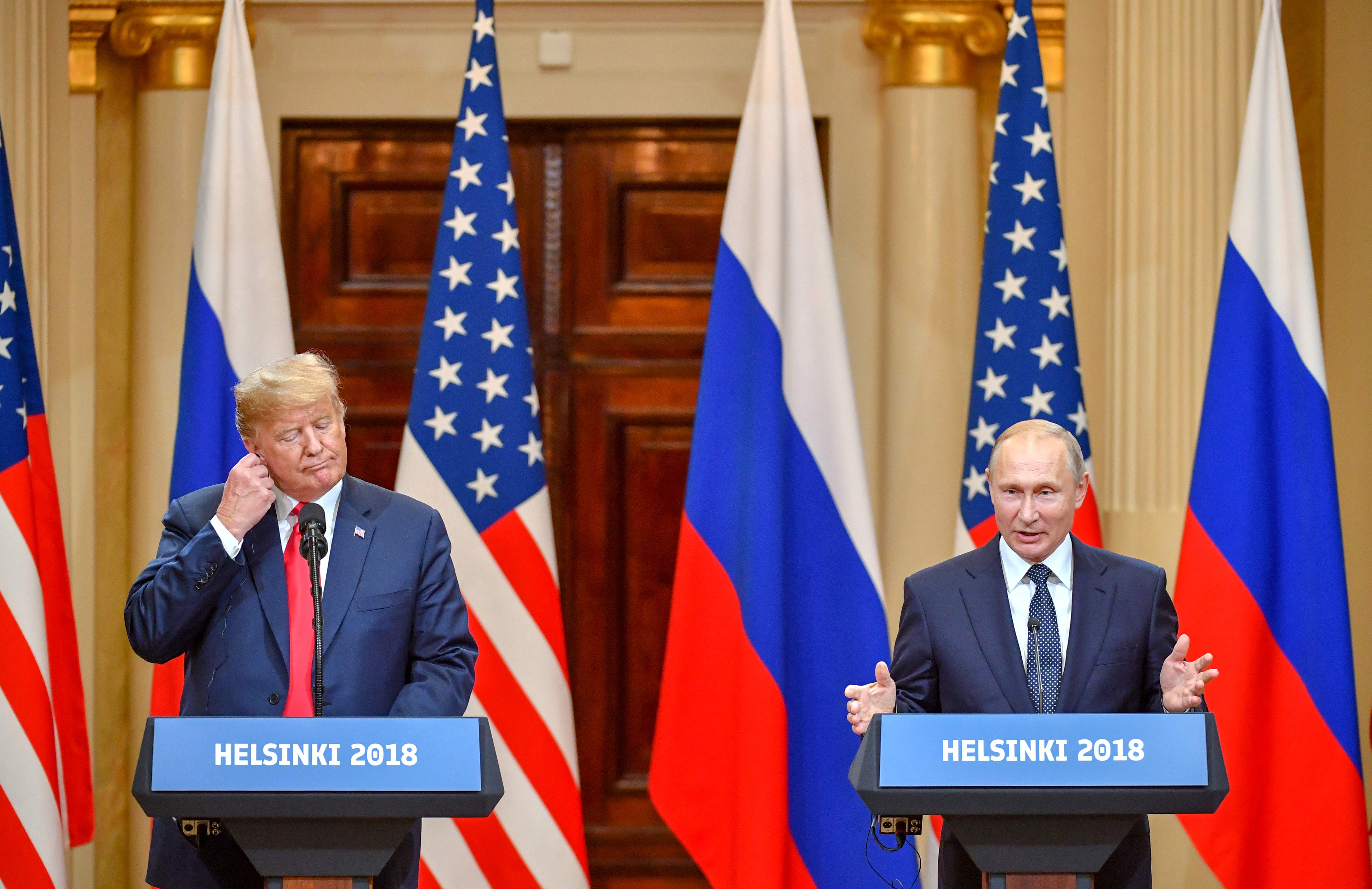 "US President Donald Trump (L) and Russia's President Vladimir Putin attend a joint press conference after a meeting at the Presidential Palace in Helsinki, on July 16, 2018. The US and Russian leaders opened an historic summit in Helsinki, with Donald Trump promising an ""extraordinary relationship"" and Vladimir Putin saying it was high time to thrash out disputes around the world.  / AFP PHOTO / Yuri KADOBNOV"