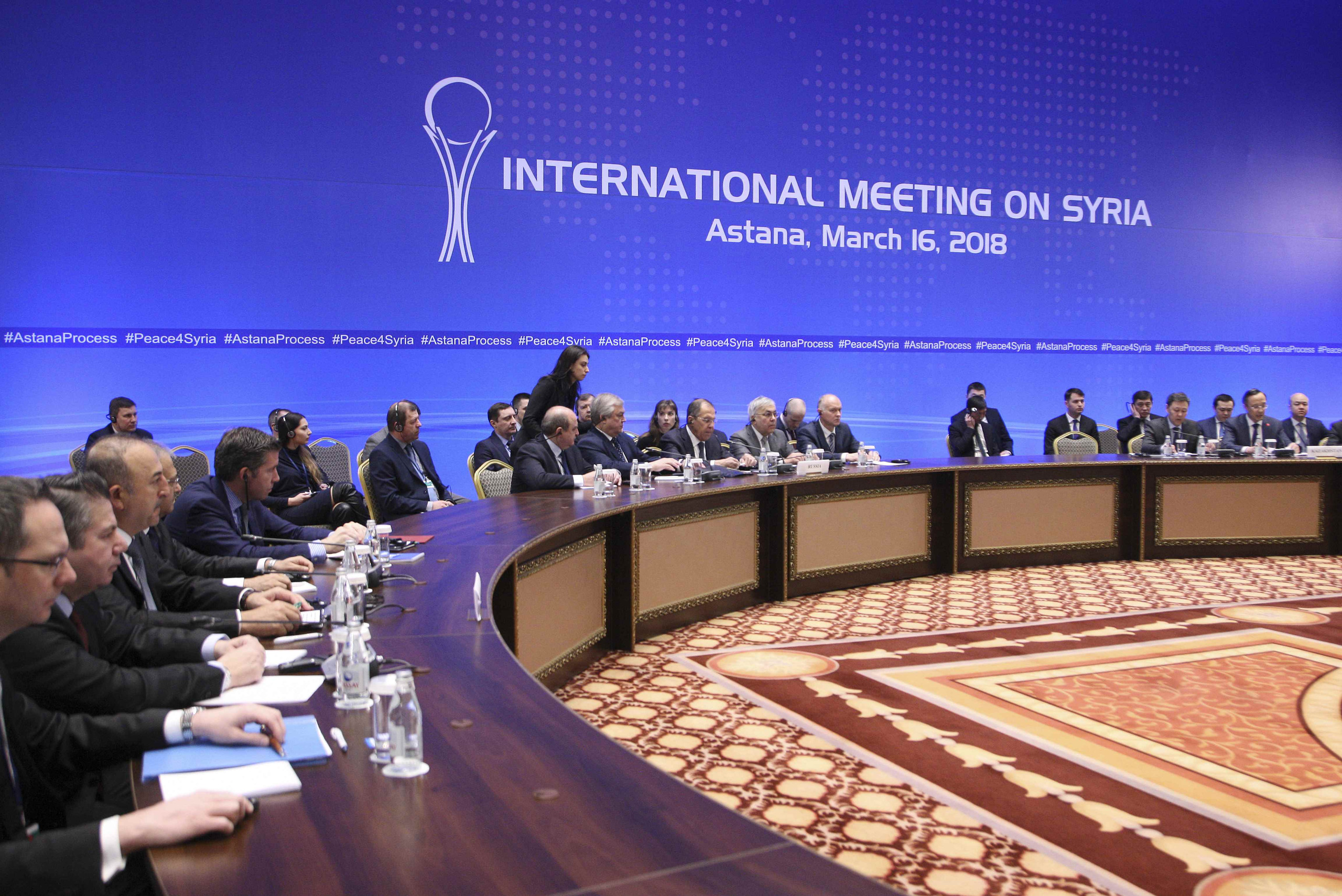Members of the delegations take part in the international meeting on Syria in Astana, Kazakhstan March 16, 2018. REUTERS/Mukhtar Kholdorbekov