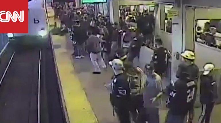 شاهد كيفية إنقاذ رجل سقط أمام قطار سريع في اللحظة الأخيرة